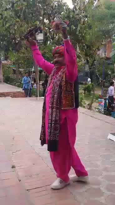 A happy sindhi visitor does exclusive dance for us after receiving free medicine at our Health Festival